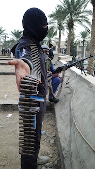 Armed Iraqi men stand guard near the home of Sunni Muslim MP Ahmed al-Alwani Photo: AFP/Getty