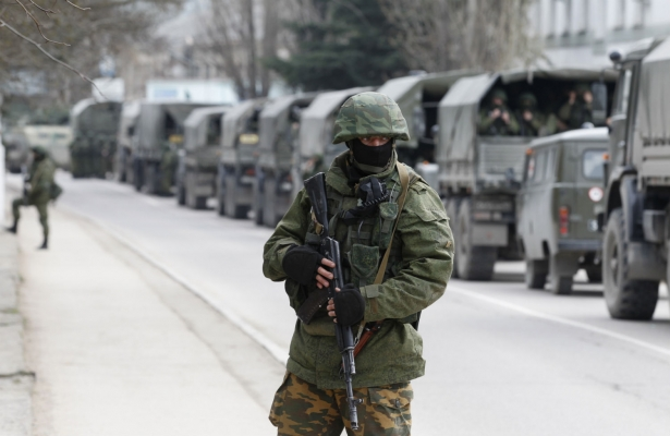 Armed servicemen wait in Russian army vehicles in the Crimean town of Balaclava, March 1, 2014. (Reuters/Baz Ratner)