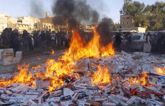 ISIS fighters burn confiscated cigarettes in the city of Raqqa, April 2, 2014. (Reuters)